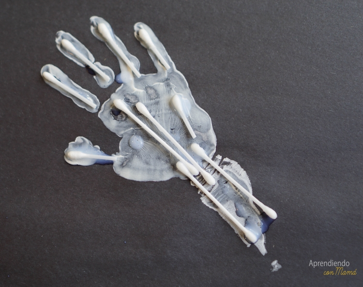 hand print with q-tips to show bones and skeleton
